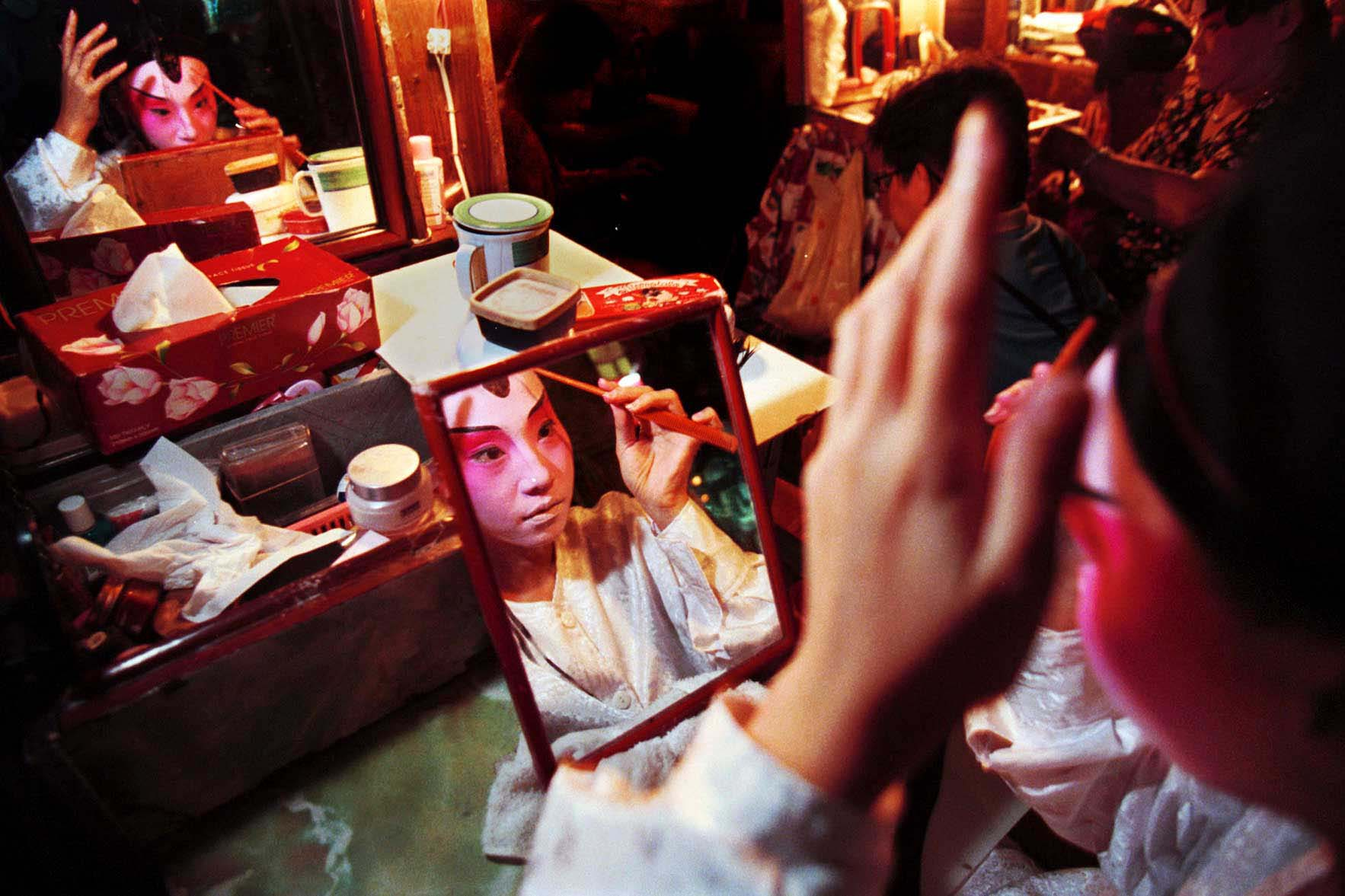 Chinese Opera Performer puts on Makeup in Singapore
